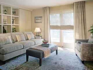 transitional interior design window treatment showing woven shade and leather banded drapery
